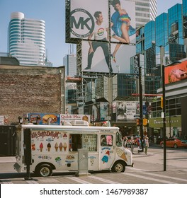 TORONTO, CANADA - JULY 31, 2019 : Ice cream van at the intersection of the Dundas Square and Yonge Street - the main street of Toronto
