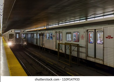 TORONTO, CANADA - JUNE 09, 2017 : Keele Subway Station on Bloor - Danforth Line. Two TTC trains arriving  simultaneously to the station