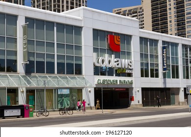 TORONTO, CANADA - JUNE 1, 2014: The outside of a Loblaws Store on a street in Toronto