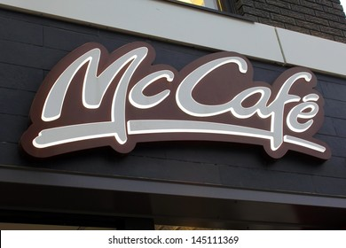 TORONTO, CANADA - JUNE 12: McDonald's McCafe sign on June 12, 2013 in downtown Toronto, Ontario, Canada. McCafe is a coffee-house-style food and drink chain, owned by McDonald's.