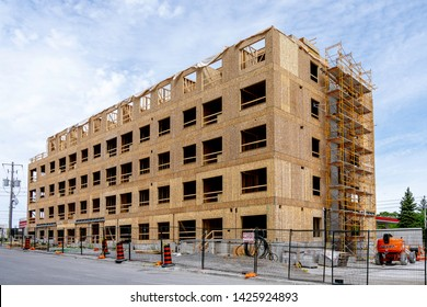 Toronto, Canada - June 16, 2019: View of Mid-Rise wood-frame construction site in Toronto, Canada.  Starting January 1, 2015 Ontario's building code will allow wood frame buildings up to six storeys