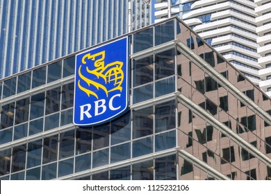 Toronto, Canada - June 19, 2018: Sign of RBC (Royal Bank of Canada) at head office in Toronto's financial district. RBC is a Canadian multinational financial services company.