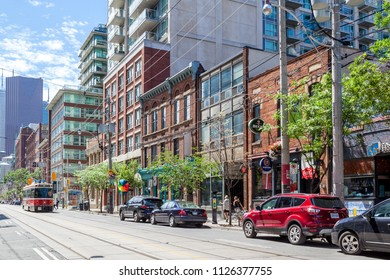 Toronto, Canada - June 19, 2018: Street view of King street west near Sherbourne St. in Toronto.