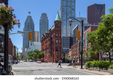 Toronto, Canada - June 19, 2018: Red-brick Gooderham Building is shown with modern buildings in background in Toronto. Gooderham Building is a historic landmark in Toronto.