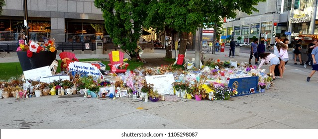 TORONTO, CANADA - JUNE 2, 2018: Signs and flowers in support of the victims of the Toronto van attack.