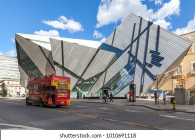 TORONTO, CANADA - June 25, 2017: Red sightseeing tour bus in front of Royal Ontario Museum in Toronto.