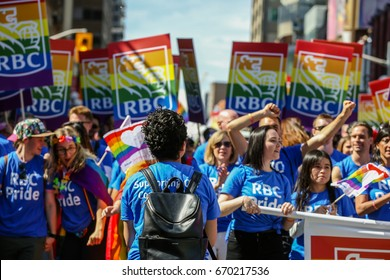 TORONTO, CANADA - JUNE 25, 2017: Royal Bank of Canada employees march with rainbow RBC Flags and Signs at 2017 Toronto Pride Parade.