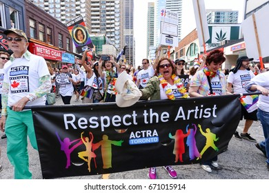 TORONTO, CANADA - JUNE 25, 2017: Members of ACTRA union march with RESPECT THE ARTIST banner at 2017 Toronto Pride Parade