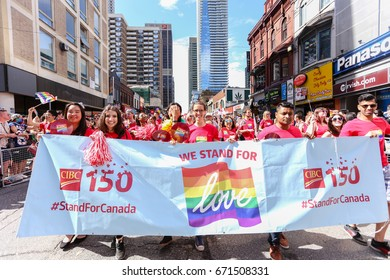 TORONTO, CANADA - JUNE 25, 2017: CIBC marchers with banner at 2017 Toronto Pride Parade.