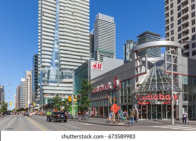 TORONTO, CANADA - JUNE 25, 2017: Bloor street looking East. Bloor-Yorkville district is one of Canada's most exclusive shopping districts.