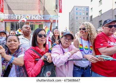TORONTO, CANADA - JUNE 25, 2017: Crowd at 2017 Toronto Pride Parade.