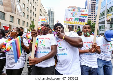 TORONTO, CANADA - JUNE 25, 2017: ACCESS ALLIANCE supporters march at 2017 Toronto Pride Parade.