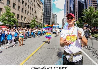 TORONTO, CANADA - JUNE 25, 2017: WALLMART employees march at 2017 Toronto Pride Parade.