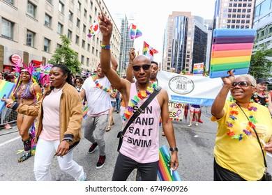 TORONTO, CANADA - JUNE 25, 2017: Marchers at 2017 Toronto Pride Parade.
