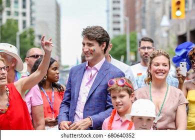 TORONTO, CANADA - JUNE 25, 2017: Ontario Premiere Kathleen Wynee, Canadian Prime Minister Justin Trudeau, Sophie Trudeau at Pride Parade.