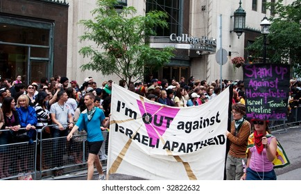 TORONTO, CANADA - JUNE 28: I'm out against Israel apartheid banner, the group marching in Toronto Pride. Toronto Gay Pride Parade, June 28, 2009
