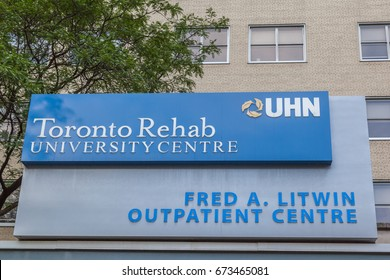 TORONTO, CANADA - JUNE 30, 2017: Sign of Toronto Rehab university Centre, the largest rehabilitation hospital in Canada in downtown and a part of the University Health Network.
