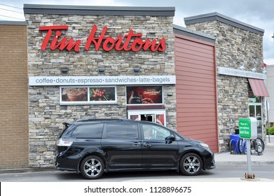 Toronto, Canada - June 5, 2018: Car in front of drive-thru of Tim Hortons restaurant.