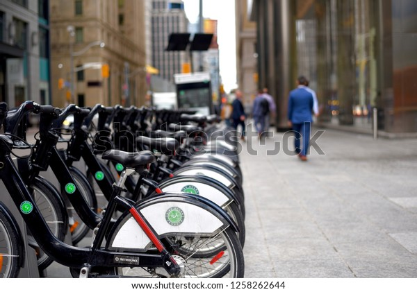 Toronto, Canada - June 5, 2018: Toronto Bike Share rental bicycles lined up in downtown Toronto