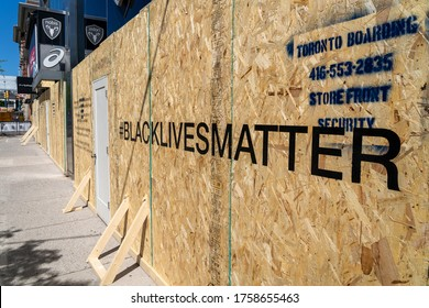 Toronto, Canada - June 6, 2020: Boarded up storefront in Downtown Toronto showing Black Lives Matter message written out front in support of social movement against racial injustice in North America.