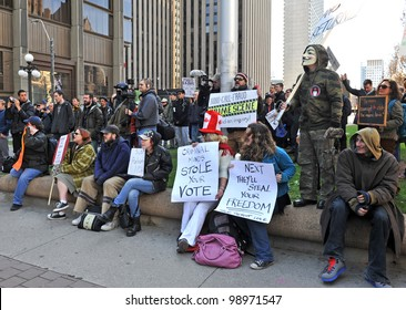TORONTO, CANADA - MAR 31:  Protesters gathered to protest the election fraud committed in the last Canadian federal election and to call for election reform Mar 31, 2012 in Toronto, Ontario.