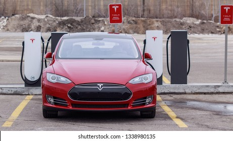 TORONTO, CANADA - MARCH 13, 2019: Tesla Model S parked plugged-in, charging at a Tesla Urban Supercharger at CF Sherway Gardens, Toronto (Etobicoke)
