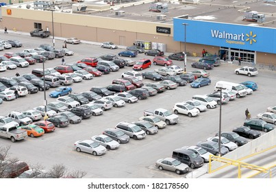 TORONTO, CANADA - MARCH 15, 2014: A parking lot in front of a Walmart store in Toronto, Canada. Walmart has 8,500 stores in 15 countries. Walmart Canada is headquartered in Mississauga, Ontario.
