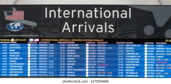 Toronto Canada, March 15, 2020; International and USA arrivals board at Toronto Pearson YYZ airport showing some cancelled flights