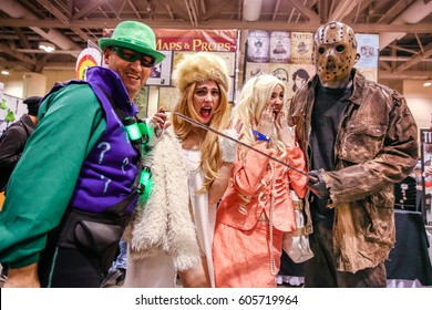 TORONTO, CANADA - MARCH 17, 2017: FRIDAY THE 13TH CHARACTER JASON VOORHEES, THE RIDDLER FROM BATMAN and TWO COSPLAY GIRLS at 2017 TORONTO COMIC CON.