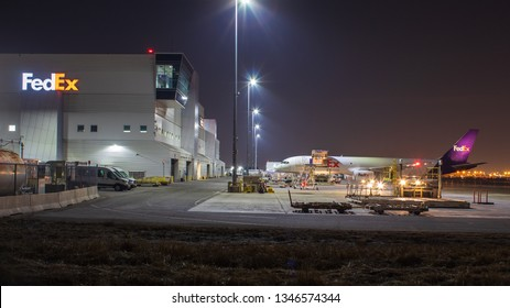 TORONTO, CANADA - MARCH 20, 2019: FedEx 757 at the FedEx Ship Centre at Toronto Pearson Intl. Airport being loaded with cargo late at night.