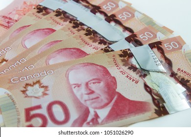 TORONTO CANADA - MARCH 21, 2018: The Canadian $50 dollar banknotes on white background
