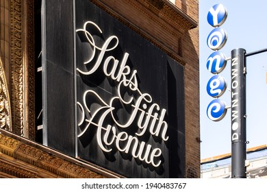Toronto Canada, March 21, 2021; Entrance sign on Canadian department store Saks Fifth Avenue in the Hudson's Bay building on Yonge Street in downtown Toronto