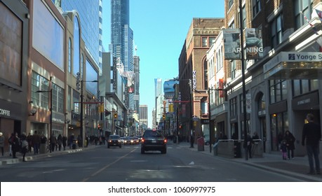 TORONTO CANADA - March 25, 2018: Yonge Street, Toronto.   Downtown Yonge street neighbourhood is an attractive destination for shopping, business and entertainment