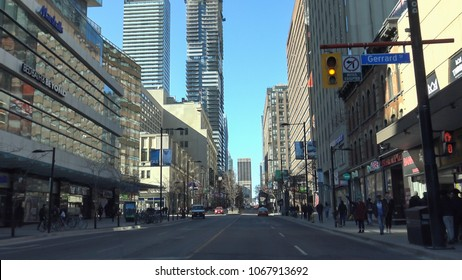 TORONTO CANADA - March 25, 2018: Busy Yonge street. Downtown Yonge street neighbourhood is an attractive destination for shopping, business and entertainment