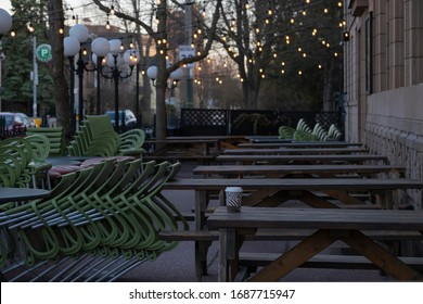 Toronto, Canada - March 27, 2020: Outdoor patio with stacked chairs and empty tables of a closed empty cafe cafe restaurant diner due to covid 19 corona virus outbreak pandemic quarantine.