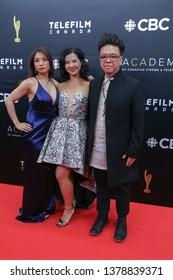 TORONTO, CANADA - MARCH 31, 2019: Amanda Joy, Samantha Wan and Romeo Candido at 2019 Canadian Screen Awards.