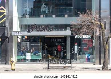 Toronto, Canada - May 05, 2019: ASICS storefront on the Queen St. in Toronto, Canada. ASICS is a Japanese multinational corporation which produces footwear and sports equipment.