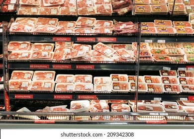 TORONTO, CANADA - MAY 06, 2014: Meat and poultry section in a supermarket. Meat industry is the largest sector of the North America food manufacturing industry.