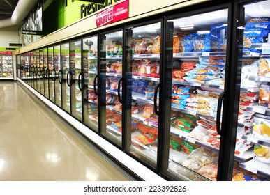 TORONTO, CANADA - MAY 06, 2014: Frozen foods aisle in a supermarket. In North America, consumption of frozen food has increased in recent years, mostly due to people's busy lifestyle.