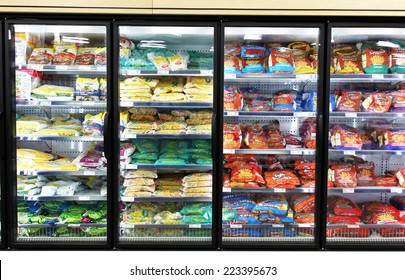 TORONTO, CANADA - MAY 06, 2014: Frozen foods on shelves in a supermarket. In North America, consumption of frozen food has increased in recent years, mostly due to people's busy lifestyle.