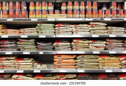 TORONTO, CANADA - MAY 06, 2014: Various beans and canned food products in a supermarket. Beans are good sources of protein, iron and fiber.