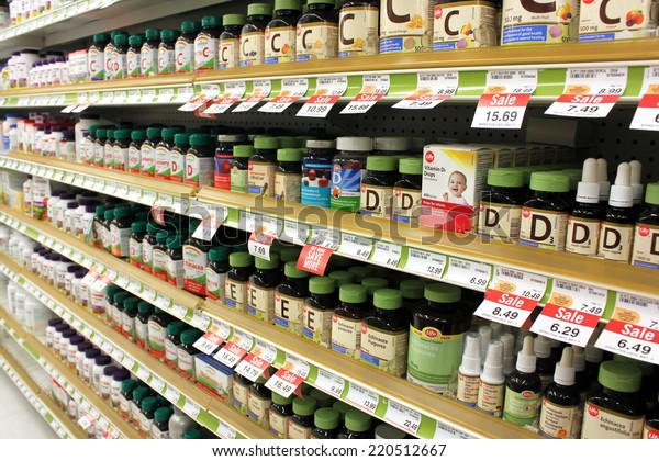 TORONTO, CANADA - MAY 07, 2014: Different types of vitamins and supplements on shelves in a pharmacy. According to studies, North America and Asia lead vitamin and supplement usage in the world.