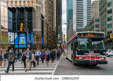 TORONTO, CANADA - MAY 09, 2018: One of the Toronto's busiest intersections: Yonge and Front Streets in a rush hour.  High - rise buildings of the Financial district at the background