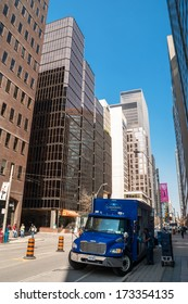 TORONTO, CANADA - MAY 10, 2007: Blue delivery truck in downtown Toronto, financial capital of Canada with 5 largest financial institutions of Canada situated in offices in Financial District.