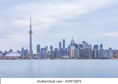 TORONTO, CANADA - MAY 12, 2015: Downtown Toronto skyline with the CN Tower , Rogers Centre and financial district skyscrapers  at twilight - illuminated