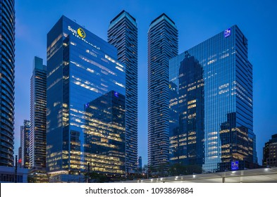 TORONTO, CANADA - MAY 18, 2018: New high - rise buildings of Sun Life Financial ,RBC Bank and the nearby skyscrapers in Downtown illuminated at dusk