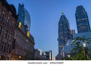 TORONTO, CANADA - MAY 20, 2018: The Beardmore building facade and nearby skyscrapers of banks and offices at the Financial District of Toronto at night