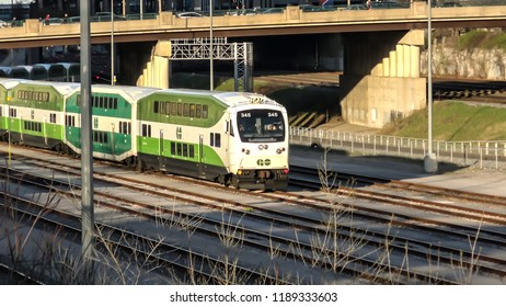 """TORONTO CANADA - MAY 2018: GO train traveling in downtown Toronto. """"GO"""" is short for (Government of Ontario). GO Transit is a regional public transit system in Ontario"""