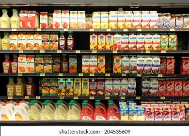 TORONTO, CANADA - MAY 26, 2014: Fruit juices on shelves in a supermarket. Fruit juice consumption overall in Europe, Australia, New Zealand and the US has increased in recent years.