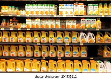 TORONTO, CANADA - MAY 26, 2014: Orange juice bottles on shelves in a supermarket. In the U.S., the major orange juice brand is Tropicana, which possesses nearly 65% of the market share.